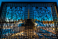 An iron gate with nude male figures at the sculpture park of Gustav Vigeland in the Frogner Park in Oslo, Norway. It is a permanent sculpture installation created by Gustav Vigeland between 1924 and 1943. It is the world's largest sculpture park made by a single artist, and is one of Norway's most popular tourist attractions. In the center is a monolith.