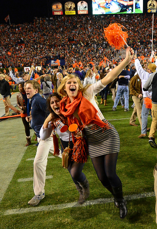 Photo by Gary Cosby Jr.  The Auburn Tigers pull off another last second miracle defeating top ranked Alabama 34-28.  Auburn fans swarm the field after the stunning victory.