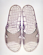 A pair of transparent beach slippers