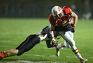 Marion's Ethan Herren (2) pulls away from Solon's Nathan Hawkins (84) after a catch during the first half of the game between the Solon Spartans and the Marion Indians at Thomas Park Field in Marion on Friday evening, October 5, 2012.