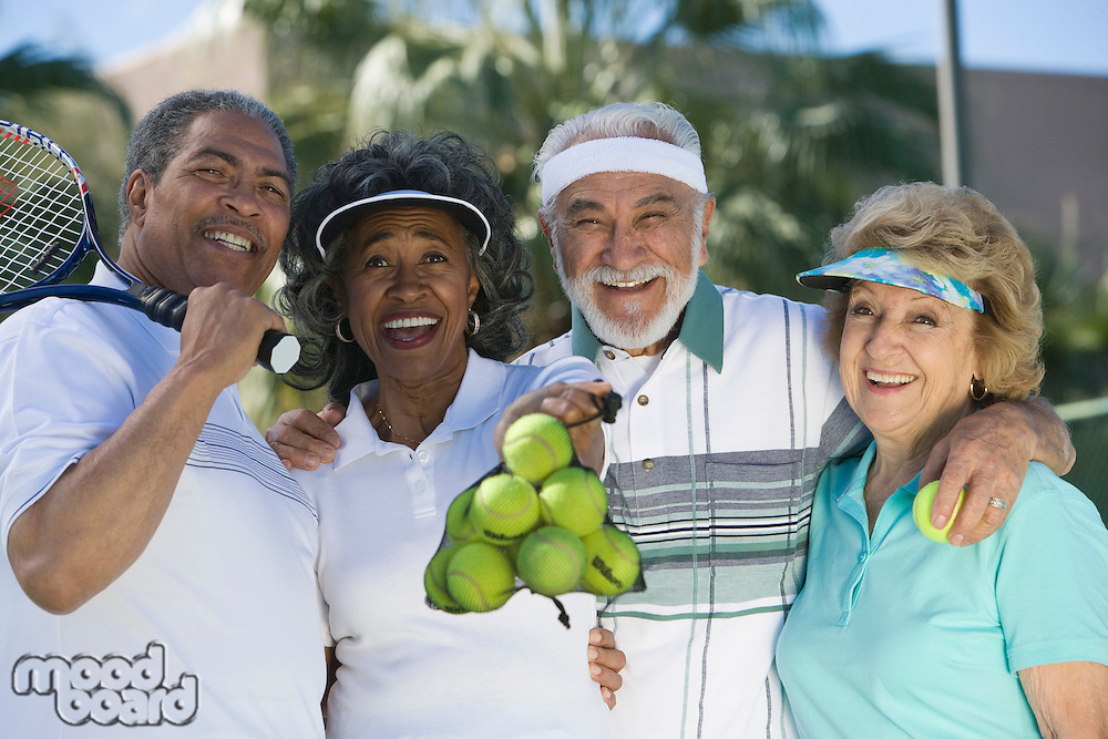 Two couples playing tennis, portrait