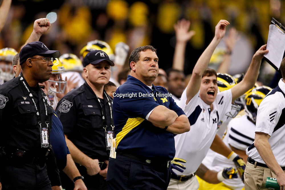 January 3, 2012; New Orleans, LA, USA; Michigan Wolverines head coach Brady Hoke watches as the game winning field goal is kicked by Michigan Wolverines kicker Brendan Gibbons (not pictured) against the Virginia Tech Hokies during the Sugar Bowl at the Mercedes-Benz Superdome. Michigan defeated Virginia 23-20 in overtime. Mandatory Credit: Derick E. Hingle-US PRESSWIRE