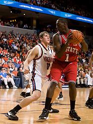 North Carolina State forward/center J.J. Hickson (1) is guarded by Virginia forward Laurynas Mikalauskas (11).  The Virginia Cavaliers men's basketball team defeated the North Carolina State Wolfpack 78-60 at the John Paul Jones Arena in Charlottesville, VA on February 24, 2008.