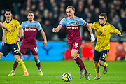 Mark Noble (Capt) (West Ham) with the ball pursued by Lucas Torreira (Arsenal) during the Premier League match between West Ham United and Arsenal at the London Stadium, London, England on 9 December 2019.