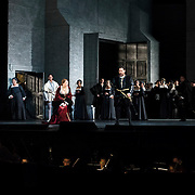 September 23, 2015 - New York, NY : The cast, including, from left, Jamie Barton (as Jane Seymour -- in black by door), Tamara Mumford (as Mark Smeaton -- in white), Sondra Radvanovsky (as Anna Bolena -- in red), Ildar Abdrazakov (as Henry VIII -- at center with sword), and Stephen Costello (as Lord Richard Percy -- at far right in brown) perform in a dress rehearsal for Gaetano Donizetti's 'Anne Bolena' at the Metropolitan Opera at Lincoln Center on Wednesday. CREDIT: Karsten Moran for The New York Times