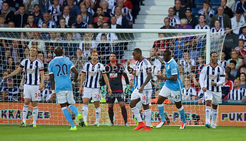 WEST BROMWICH, ENGLAND - Monday, August 10, 2015: Manchester City's Yaya Toure celebrates scoring the first goal against West Bromwich Albion during the Premier League match at the Hawthorns. (Pic by David Rawcliffe/Propaganda)