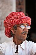 Indian man wears traditional Rajasthani turban in Narlai village in Rajasthan, Northern India