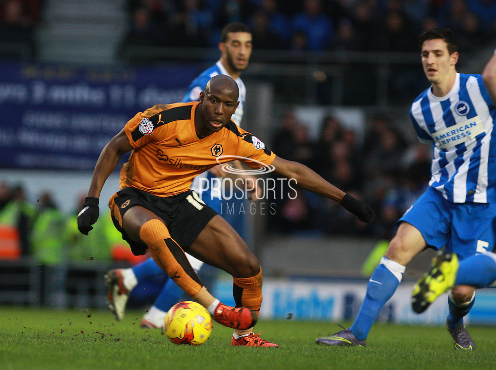 Wolverhampton Wanderers striker Benik Afobe looks to get the better of Brighton central defender Lewis Dunk during the Sky Bet Championship match between Brighton and Hove Albion and Wolverhampton Wanderers at the American Express Community Stadium, Brighton and Hove, England on 1 January 2016. Photo by Bennett Dean.