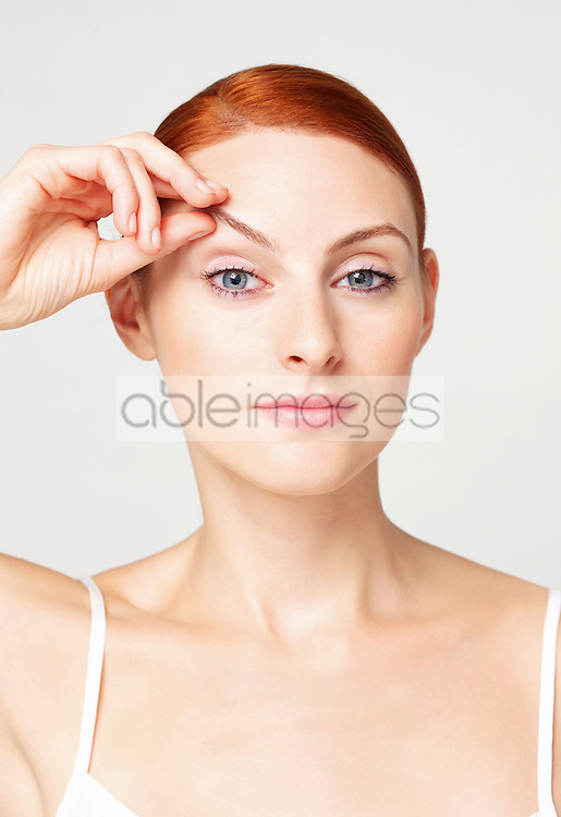 Woman Lifting Eyebrow with her Hand