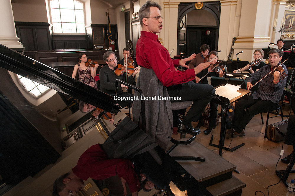 John Landor, London Musical Arts Orchestra musical director at work in St-Martin-in-the-Fields church, Trafalgar Square, London, UK.