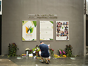 15 NOVEMBER 2015 - BANGKOK, THAILAND: A man prays at the gate of the French Embassy in Bangkok, Thailand. Security was heightened at the embassy after terrorists attacked civilian targets in Paris, France, on Nov. 13. The terrorists, affiliated with IS/ISIL killed more than 120 people. People left flowers at the gate to the embassy.         PHOTO BY JACK KURTZ