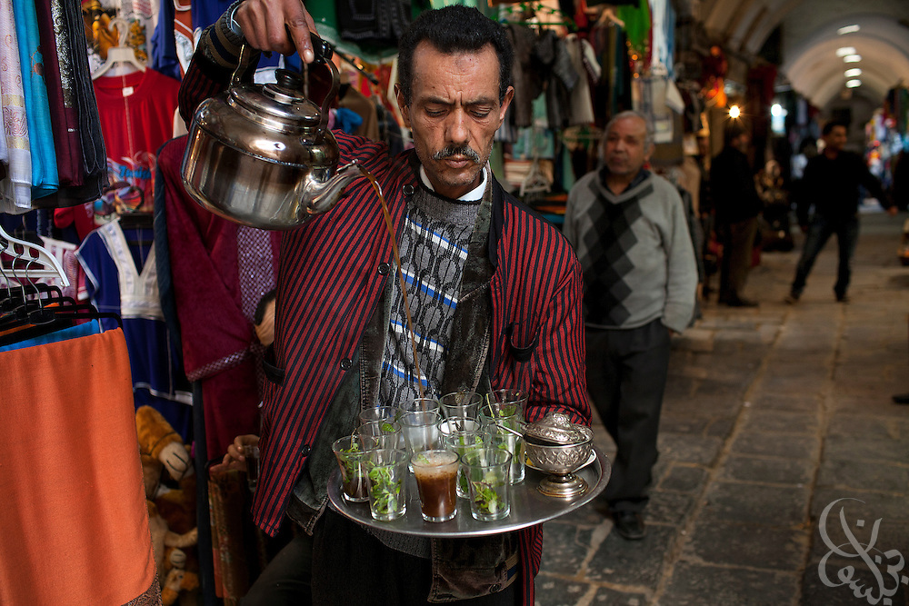 A Tunisian tea vendor waits for customers near the Zeitouna mosque in the old medina area March 05, 2012 in Tunis, Tunisia. The area is normally crowded with foreign tourists, however in the year since the revolution tourism numbers are dramatically down. (Photo by Scott Nelson for Elsevier)