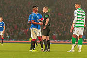 Match Referee William Collum has a word with Alfredo Morelos of Rangers FC during the Betfred Scottish League Cup Final match between Rangers and Celtic at Hampden Park, Glasgow, United Kingdom on 8 December 2019.