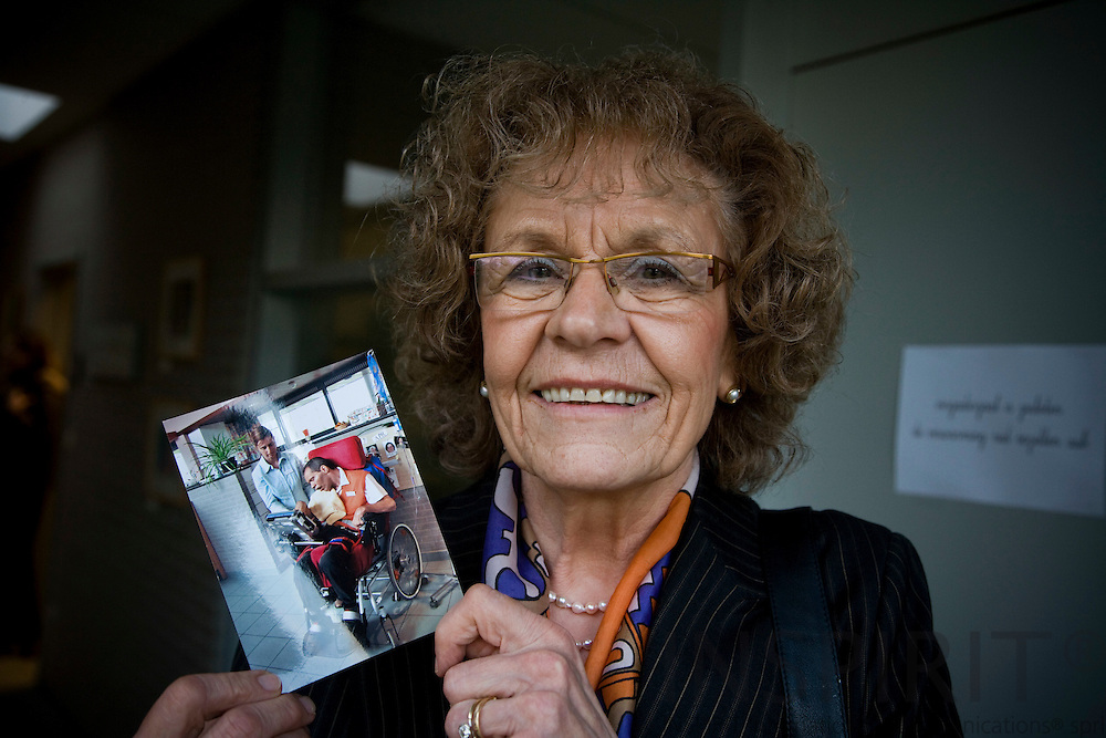 ZOLDER - BRUSSELS - BELGIUM - 19 NOVEMBER 2009 -- Josephine Nicolaas Houben at the hospital in Heusden-Zolder, holding a picture of her son Rom Houben. People thought for 23 years that Rom Houben was in a coma after a car accident in 1983. Three years ago Doctor Steven Laureys gave him a specially-adapted computer and then discovered he was not in a coma. It showed up that he was paralysed and unable to communicate. He now communicates via a computer and with the help of a specialized speech therapist. PHOTO: ERIK LUNTANG