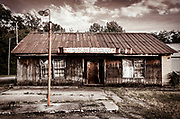 This abandoned old store lies in ruin, having outlived it perceived usefulness.  The image was processed to emulate vintage Kodachrome slide film.