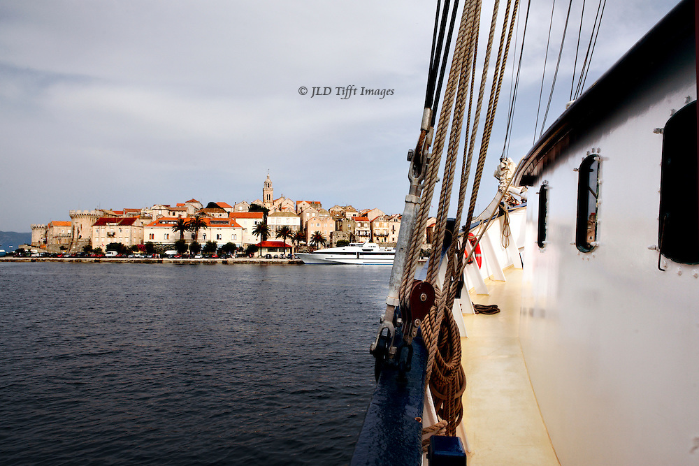 View of Korcula town from the water, along the side of the sailboat, at a few hundred meters away.