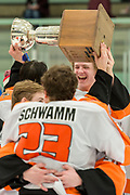 Players<br /> pass around the championship cup after their<br /> win at the 2015 State Hockey Championships at the Curtis D. Menard Memorial Sports Center Saturday night. WHS won 4-3.
