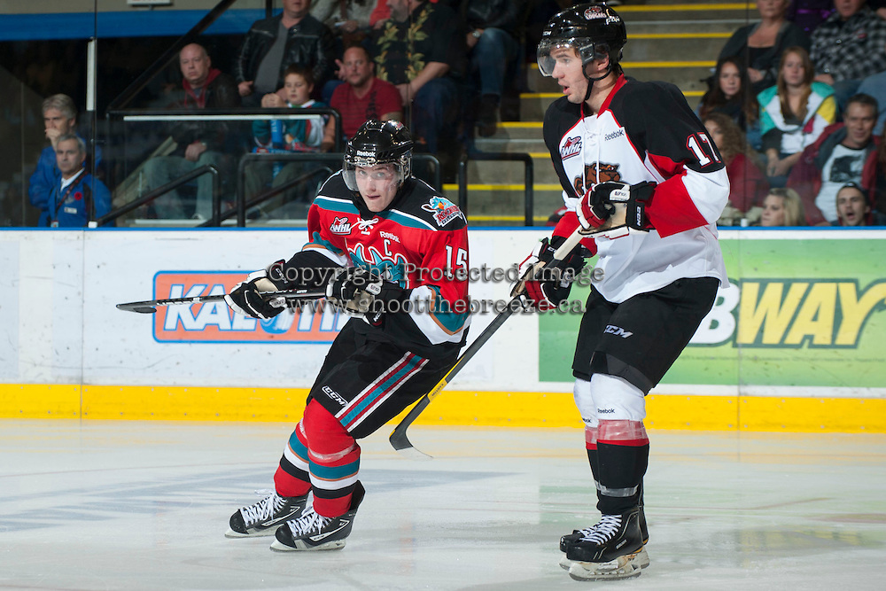 KELOWNA, CANADA - NOVEMBER 3:  Colton Sissons #15 of the Kelowna Rockets skates on the ice while checked by Caleb Belter #17 of the Prince George Cougars at the Kelowna Rockets on November 3, 2012 at Prospera Place in Kelowna, British Columbia, Canada (Photo by Marissa Baecker/Shoot the Breeze) *** Local Caption ***
