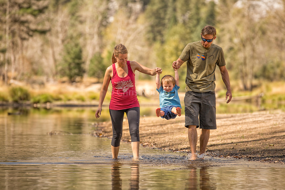 Fitz Caldwell (age 2.5) getting some air with the help of his parents Tommy and Becca on a rest day along the Merced River in Yosemite National Park.