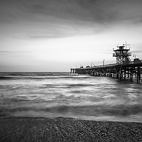 San Clemente pier black and white photography. San Clemente California is a popular beach town in Orange County in the United States of America. Copyright ⓒ 2017 Paul Velgos with all rights reserved.