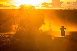 El Diamante, Meta, Colombia - 17.09.2016        <br /> <br /> FARC fighters drive during sunset on a motorbike on a dirt road to the 10th conference of the marxist FARC-EP in El Diamante, a Guerilla controlled area in the Colombian district Meta. Few days ahead of the peace contract passing after 52 years of war with the Colombian Governement wants the FARC decide on the 7-days long conferce their transformation into a unarmed political organization. <br /> <br /> FARC Kaempfer fahren im Sonnenuntergang auf einem staubigen Weg zur zehnten Konferenz der marxistischen FARC-EP in El Diamante, einem von der Guerilla kontrollierten Gebiet im kolumbianischen Region Meta. Wenige Tage vor der geplanten Verabschiedung eines Friedensvertrags nach 52 Jahren Krieg mit der kolumbianischen Regierung will die FARC auf ihrer sieben taegigen Konferenz die Umwandlung in eine unbewaffneten politischen Organisation beschlieflen. <br />  <br /> Photo: Bjoern Kietzmann