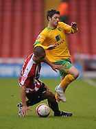 Sheffield - Saturday January 9th, 2009: Kyle Naughton of Sheffield United and Wesley Hoolahan of Norwich City during the Coca Cola Championship match at Bramall Lane, Sheffield. (Pic by Alex Broadway/Focus Images)