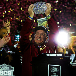 Florida State head coach Jimbo Fisher holds-up the championship trophy after defeating Auburn 34-31 during the BCS National Championship game at the Rose Bowl in Pasadena, Calif., on Monday, Jan. 6, 2014.
