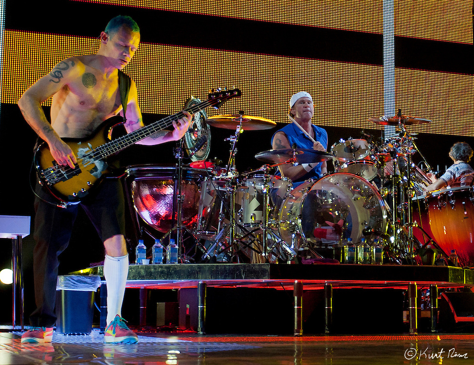 March 31, 2012 - Orlando, Florida, U.S. - The Red Hot Chili Peppers bass player FLEA and drummer CHAD SMITH perform at the Amway Center in Orlando, Florida.