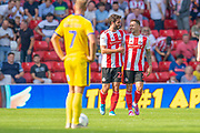 Chris Maguire (#7) of Sunderland AFC celebrates with Will Grigg (#22) after scoring the third goal for Sunderland during the EFL Sky Bet League 1 match between Sunderland and AFC Wimbledon at the Stadium Of Light, Sunderland, England on 24 August 2019.