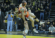 January 07, 2011: Iowa's Tony Ramos takes Oklahoma State's Jordan Oliver tries to score a takedown on during the 133-pound bout in the NCAA wrestling dual between the Oklahoma State Cowboys and the Iowa Hawkeyes at Carver-Hawkeye Arena in Iowa City, Iowa on Saturday, January 7, 2012. Ramos won 4-3.