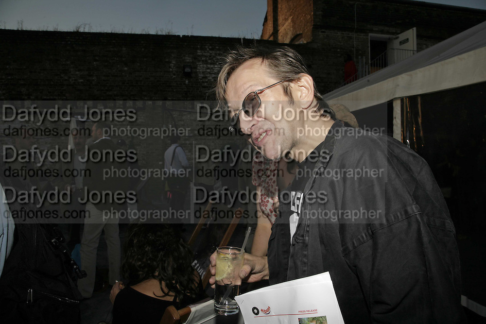Michael Wojas, Ribena: Space And The City - private view, Proud Camden, Stables Market, The Gin House, London, NW1,Exhibition featuring  photographs of the photographers favorite urban relaxation spot. Following exhibition, the photographs are auctioned for The Wildlife Trust. 10 August 2006.  more...ONE TIME USE ONLY - DO NOT ARCHIVE  © Copyright Photograph by Dafydd Jones 66 Stockwell Park Rd. London SW9 0DA Tel 020 7733 0108 www.dafjones.com