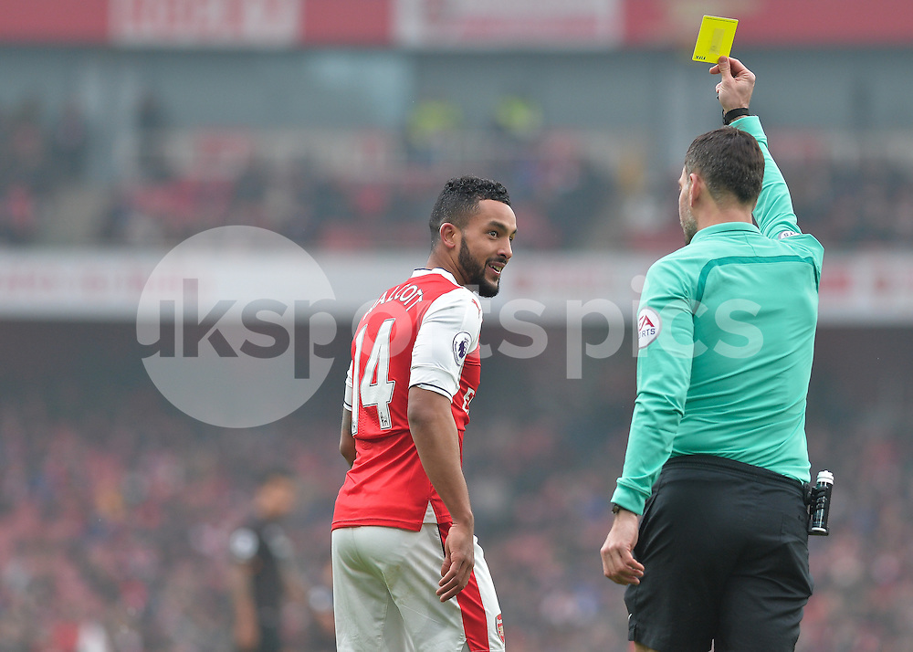 Theo Walcott of Arsenal is shown the yellow card by Referee Mark Clattenburg during the Premier League match between Arsenal and Hull City at the Emirates Stadium, London, England on 11 February 2017. Photo by Vince  Mignott.