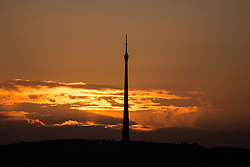 © Licensed to London News Pictures. 07/03/2016. Emley Moor UK. This morning's sun rises behind the 1,084 ft Emley Moor Transmitter in Yorkshire. Photo credit: Andrew McCaren/LNP