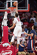 FAYETTEVILLE, AR - FEBRUARY 27:  Daniel Gafford #10 of the Arkansas Razorbacks goes up for a dunk during a game against the Auburn Tigers at Bud Walton Arena on February 27, 2018 in Fayetteville, Arkansas.  The Razorbacks defeated the Tigers 91-82.  (Photo by Wesley Hitt/Getty Images) *** Local Caption *** Daniel Gafford