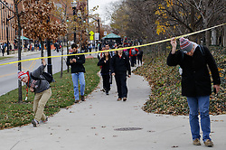 November 28, 2016 - Columbus, Ohio, USA - Ohio State students duck under police tape after a shelter-in-place notification was lifted following an attack on Monday,  at The Ohio State University in Columbus, Ohio. (Credit Image: © Joshua A. Bickel/TNS via ZUMA Wire)