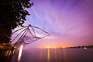 Chinese fishing nets at down in fort Kochi, Kerala. India <br /> Photo by Lorenz Berna