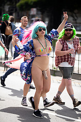 A woman wearing a fake phallus mugs for the camera at the 107th running of the Bay to Breakers, Sunday, May 20, 2018, in San Francisco. (Photo by D. Ross Cameron)