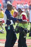 18 September 2011: Secondary coach Brett Maxie of the Dallas Cowboys speaks to 49ers team photographer Terrell Lloyd before the Cowboys 27-24 overtime victory against the 49ers in an NFL football game at Candlestick Park in San Francisco, CA