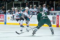 KELOWNA, CANADA - JANUARY 24: Leon Draisaitl #29 of Kelowna Rockets skates with the puck while Ben Betker #5 of Everett Silvertips checks on January 24, 2015 at Prospera Place in Kelowna, British Columbia, Canada.  (Photo by Marissa Baecker/Shoot the Breeze)  *** Local Caption *** Leon Draisaitl; Ben Betker;