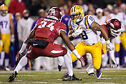 FAYETTEVILLE, AR - NOVEMBER 15:  Terrence Magee #18 of the LSU Tigers is tackled by Braylon Mitchell #34 of the Arkansas Razorbacks at Razorback Stadium on November 15, 2014 in Fayetteville, Arkansas.  The Razorbacks defeated the Tigers 17-0.  (Photo by Wesley Hitt/Getty Images) *** Local Caption *** Terrence Magee; Braylon Mitchell