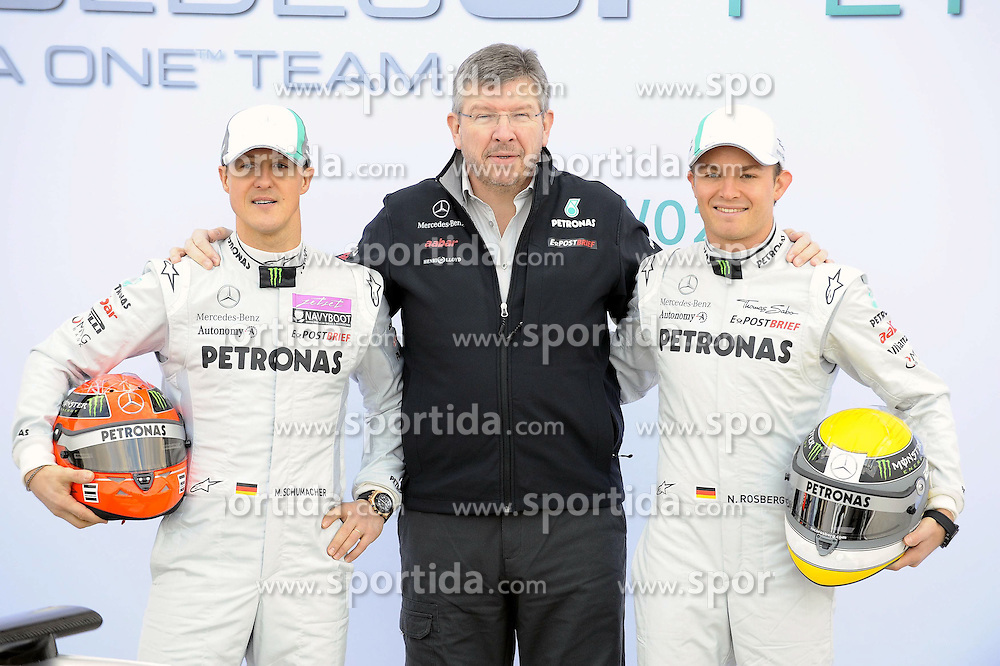 01.02.2011, Street Circuit. Jerez, ESP, Formel 1 Test 1 Valencia 2011,  im Bild  Mercedes Launch - Mercedes W02 Launch 2011 - Michael Schumacher (GER), Mercedes GP - Ross Brawn (GBR) Team Owner, Brawn GP F1 Team  - Nico Rosberg (GER), Mercedes GP   EXPA Pictures © 2011, PhotoCredit: EXPA/ nph/  Dieter Mathis   ****** out of GER / SWE / CRO  / BEL ******