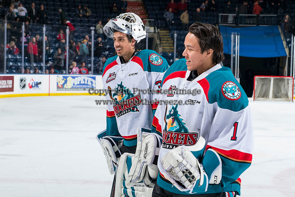 KELOWNA, BC - MARCH 03:  James Porter #1 and Roman Basran #30 of the Kelowna Rockets skate to the bench after the win against the Portland Winterhawks at Prospera Place on March 3, 2019 in Kelowna, Canada. (Photo by Marissa Baecker/Getty Images)