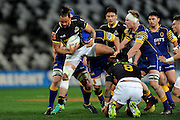 Matt Proctor of Wellington gets caught by the defence during the Mitre 10 Competition match between Otago and Wellington at Forsyth Barr Stadium on August 25, 2016 in Dunedin, New Zealand. Credit: Joe Allison / www.Photosport.nz