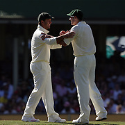 Australian captain Ricky Ponting shares a joke with team mate Michael Hussey  during day four of the third test match between Australia and South Africa at the Sydney Cricket Ground on January 6, 2009 in Sydney, Australia. Photo Tim Clayton
