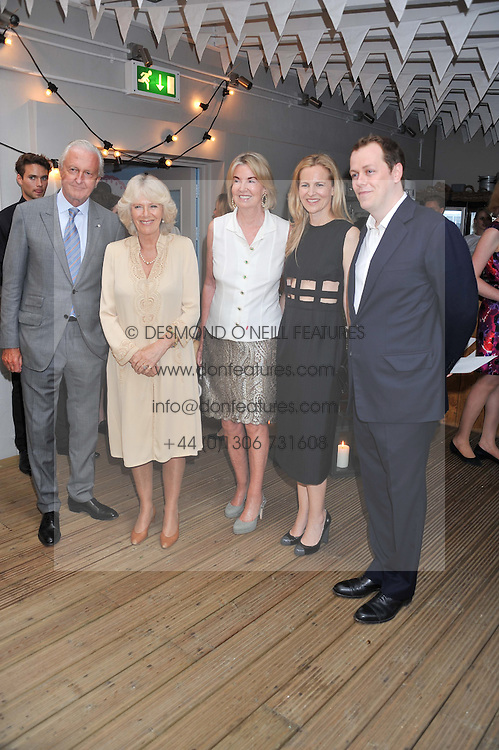 Left to right, GALEN WESTON, HRH The DUCHESS OF CORNWALL, HILARY WESTON, ALANNAH WESTON and TOM PARKER BOWLES at a party to celebrate the publication on 'Let's Eat: Recipes From My Kitchen Notebook' by Tom Parker Bowles held at Selfridge's Rooftop. Selfridge's, Oxford Street, London on 27th June 2012.