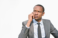 African American businessman on a call over white background