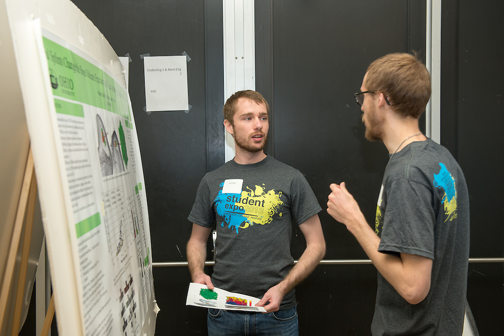 Ohio University Student Expo participants Will Zaylor (Left) and Arlin Bradford (Right) discuss their projects on display at the Convocation Center on Thursday, April 11, 2013. Photo by Ben Siegel