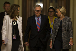 July 28, 2017 - Washington, District Of Columbia, USA - Senate Majority Leader Sen. MITCH MCCONNELL (R-KY) leaves the senate chamber accompanied by his staff after the senate voted down republican efforts to repeal The Affordable Care Act 49-51 with 3 republican senators voting against the bill with the democrats. (Credit Image: © Alex Edelman via ZUMA Wire)
