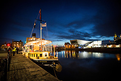 "© Licensed to London News Pictures. 04/05/2016. Birkenhead UK. Picture shows the Daniel Adamson in it's new temporary home at Canning Docks in Liverpool. The Daniel Adamson steam boat has been bought back to operational service after a £5M restoration. The coal fired steam tug is the last surviving steam powered tug built on the Mersey and is believed to be the oldest operational Mersey built ship in the world. The ""Danny"" (originally named the Ralph Brocklebank) was built at Camel Laird ship yard in Birkenhead & launched in 1903. She worked the canal's & carried passengers across the Mersey & during WW1 had a stint working for the Royal Navy in Liverpool. The ""Danny"" was refitted in the 30's in an art deco style. Withdrawn from service in 1984 by 2014 she was due for scrapping until Mersey tug skipper Dan Cross bought her for £1 and the campaign to save her was underway. Photo credit: Andrew McCaren/LNP ** More information available here http://tinyurl.com/jsucxaq **"