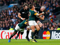New Zealand Lock Brodie Retallick is tackled by South Africa Fly-Half Handre Pollard and Prop Tendai Mtawarira - Mandatory byline: Rogan Thomson/JMP - 07966 386802 - 24/10/2015 - RUGBY UNION - Twickenham Stadium - London, England - South Africa v Wales - Rugby World Cup 2015 Semi Finals.
